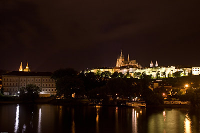 Prague Castle across River at Night