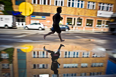 Reflected Runner in Puddle