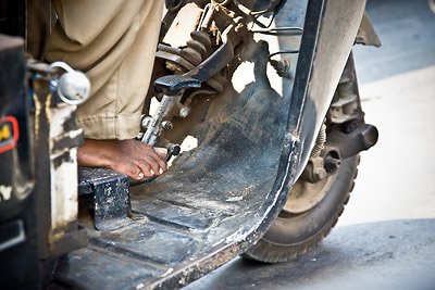 Feet of Rickshaw driver
